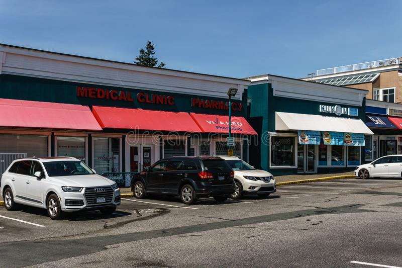 SURREY, CANADA - May 5, 2019: Sunshine Village Strip mall or shopping plaza sunny spring day. America, parking, sky, architecture, building, center, commercial stock photo