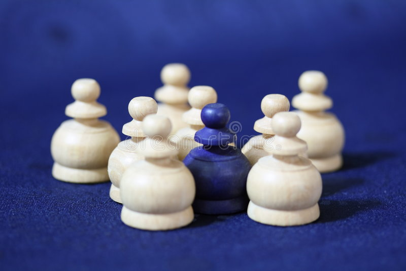 Surrounded chess pawn royalty free stock image