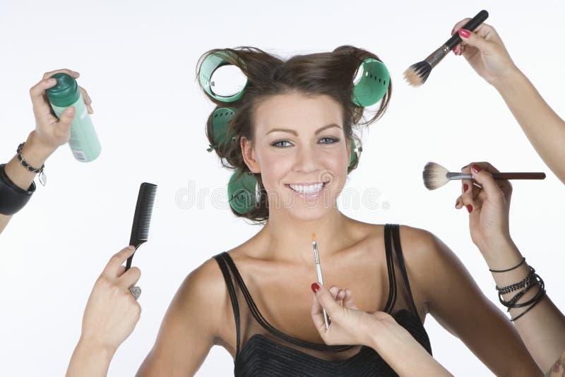 Surrounded With Hands modèle féminin tenant des cosmétiques image stock