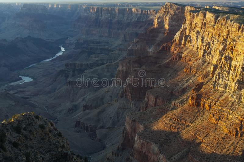 Surrounding the Colorado River, the Grand Canyon takes on an orange hue under the setting sun. Named a UNESCO World Heritage Site in 1979, the Grand Canyon royalty free stock photo