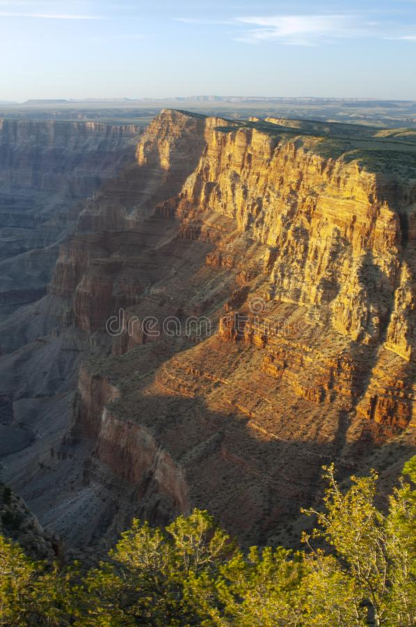 A view of the cliffs and depth of the Grand Canyon as the sun begins to set. Named a UNESCO World Heritage Site in 1979, the Grand Canyon National Park is royalty free stock image