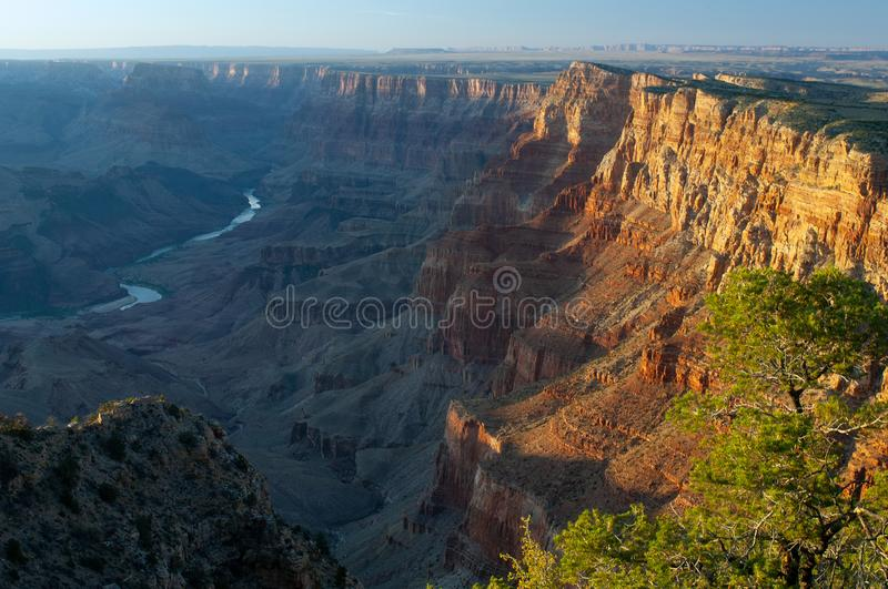 Surrounding the Colorado River, the Grand Canyon takes on an orange hue under the setting sun. Named a UNESCO World Heritage Site in 1979, the Grand Canyon stock image