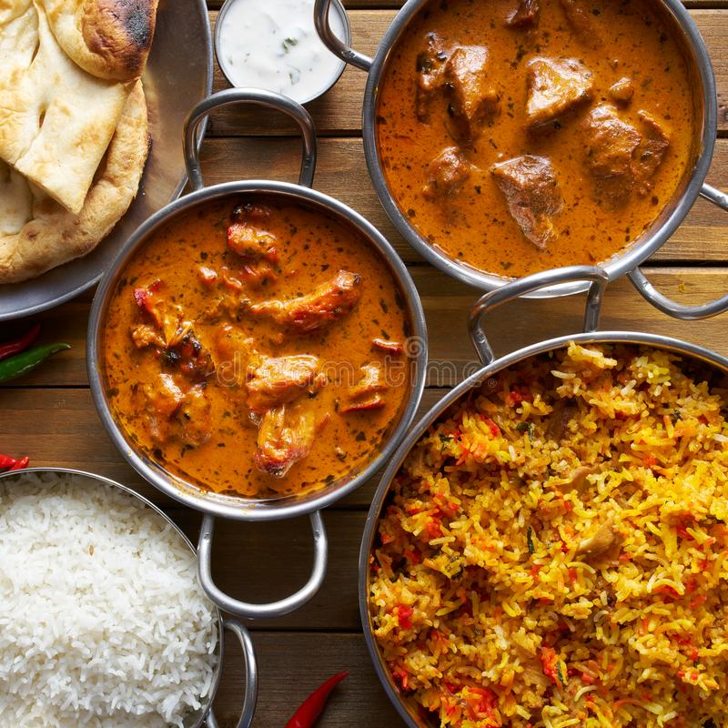 Surtido de platos indios del curry y del arroz imagen de archivo