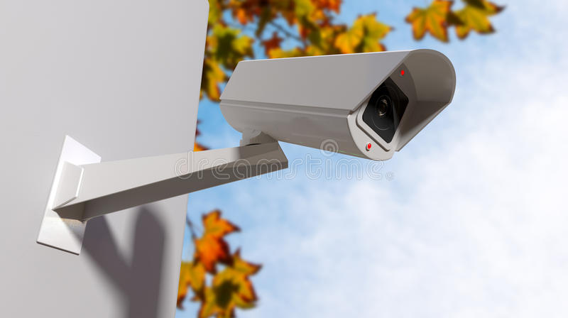 Surveillance Camera In The Daytime. A white wireless surveillance camera with illuminated lights mounted on a wall in the daytime with copy space royalty free illustration
