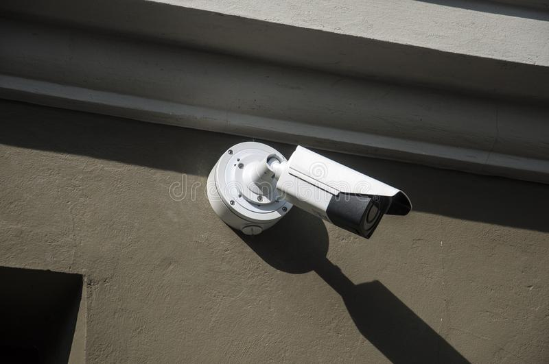Surveillance camera. On side of the building royalty free stock photography
