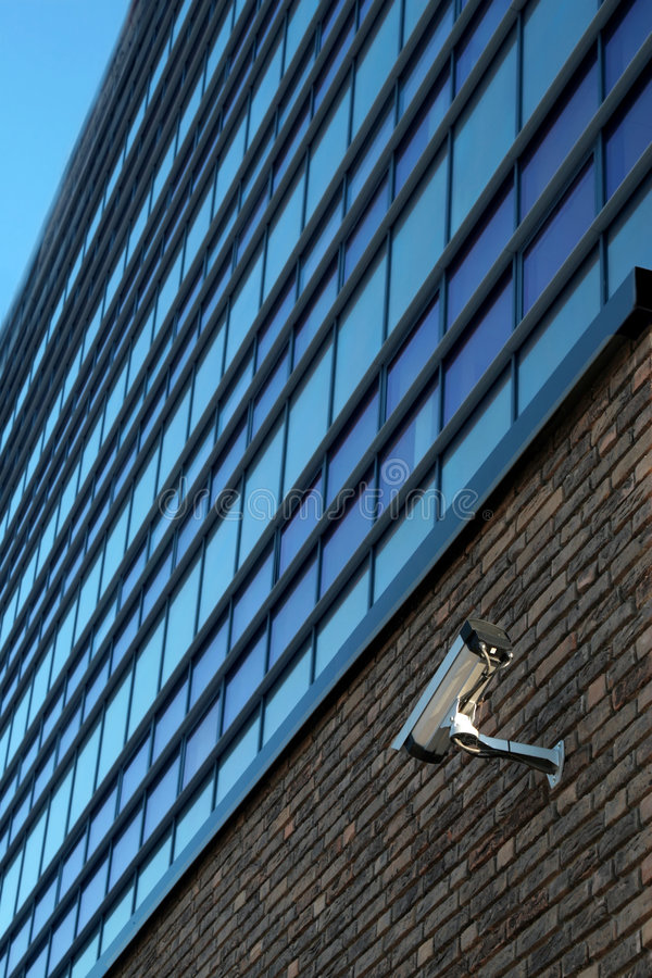 Surveillance camera on wall royalty free stock images