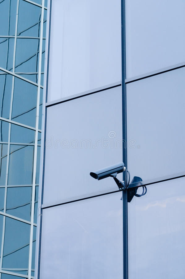 Surveillance camera on the wall of modern building stock photos