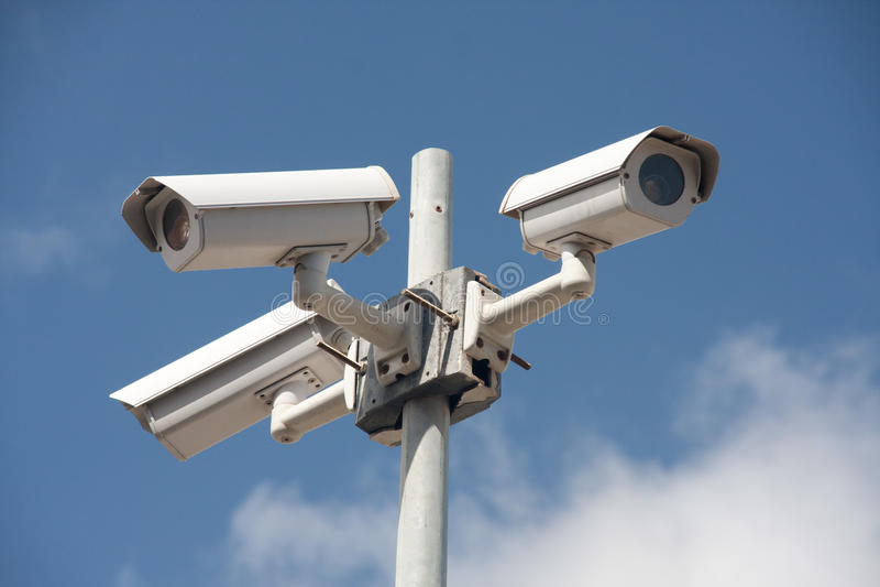 Surveillance cameras stock photography