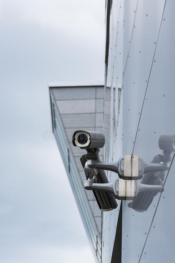 Surveillance Cameras. On a building Wall royalty free stock photos
