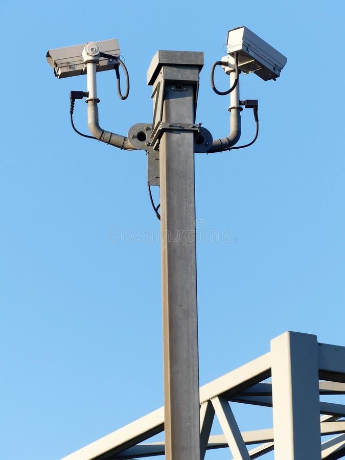 Surveillance cameras monitoring motorway traffic on the M25 royalty free stock photos