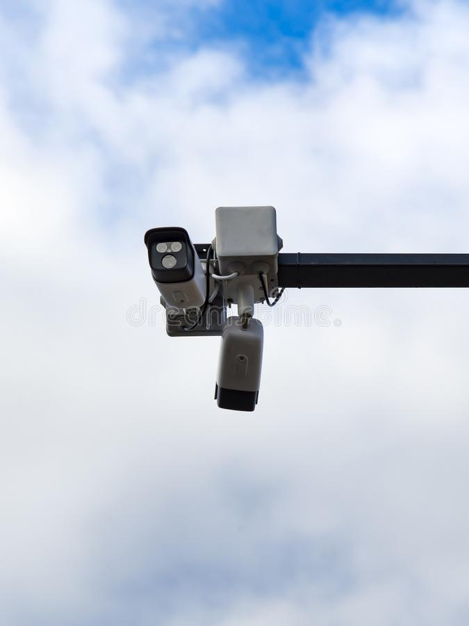Surveillance cameras. In front of blue sky stock photo