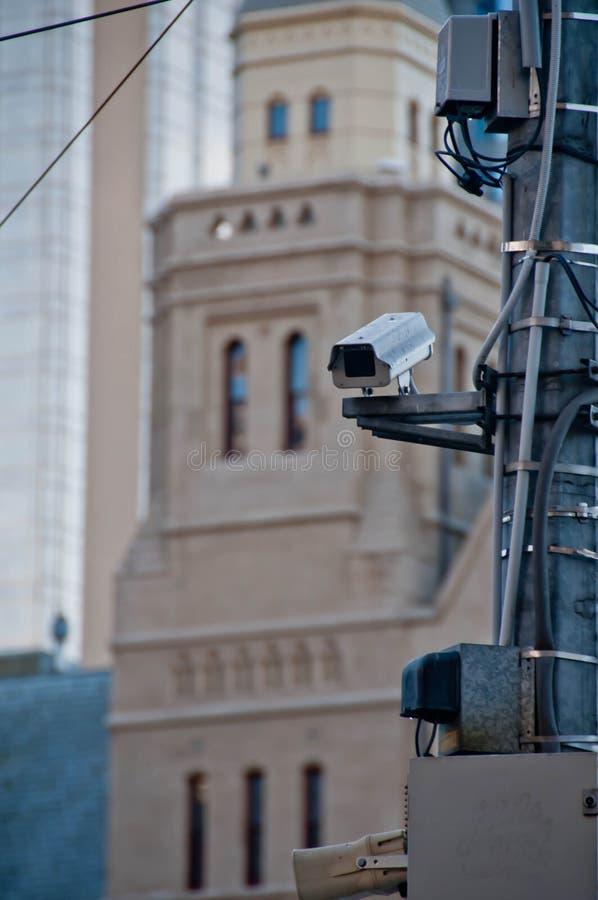 Surveillance CCTV street outdoor camera watching pedestrian near. European cathedral church in city center to prevent terrorism stock photography