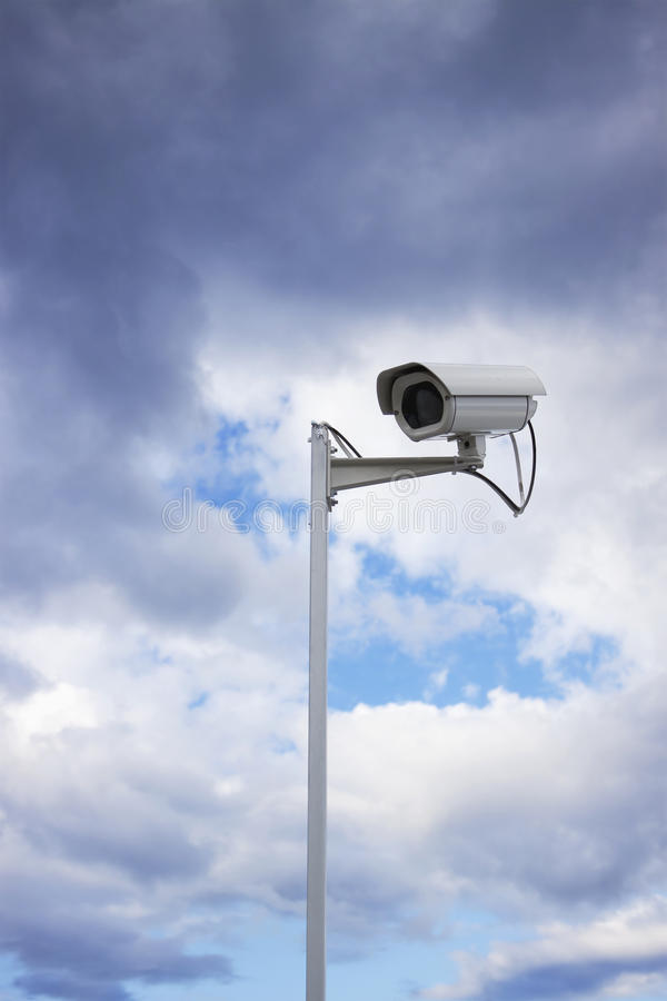 Free Surveillance Security Camera And Cloudy Sky Stock Photo - 10924860