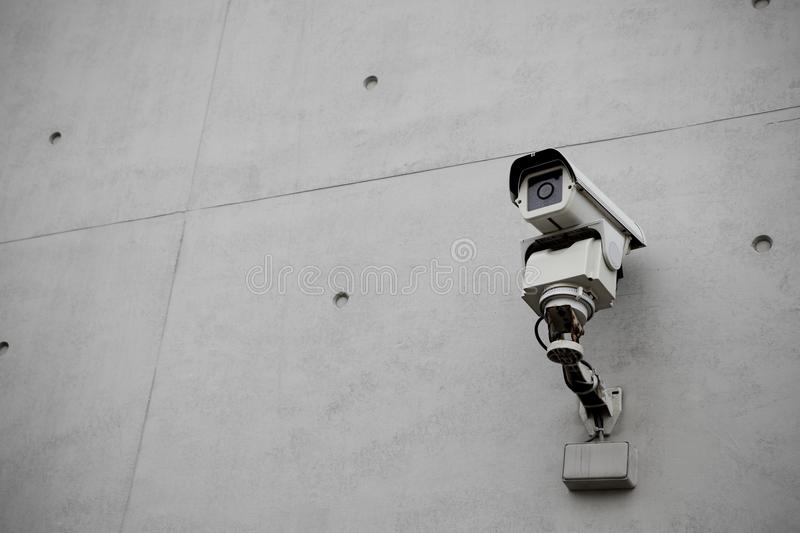 Surveillance Security Camera with concrete wall stock photo