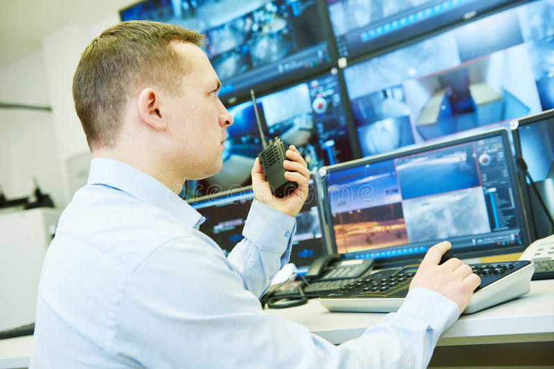 Surveillance security system. Video monitoring woker stock images