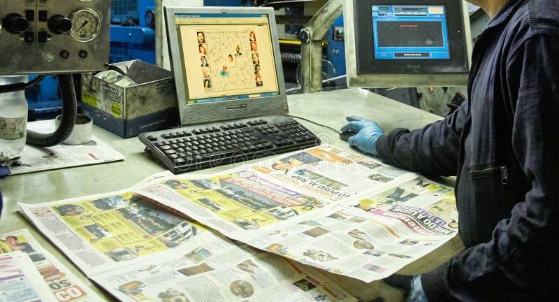 Surveillant d'industrie imprimée photo stock