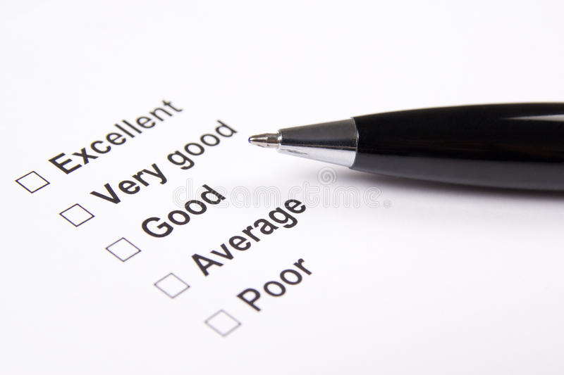 Survey with excellent, very good, good, average and poor answers. And metal pen royalty free stock image