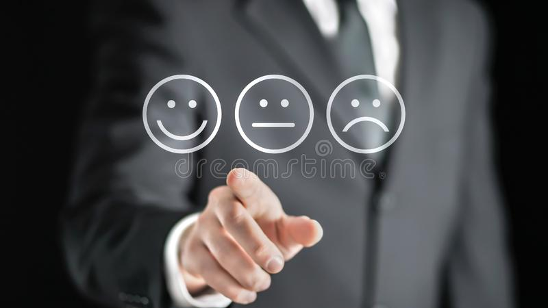 Survey, giving feedback, poll questionnaire and customer experience concept. Business man push digital touch screen to tell positive opinion, rating or review stock photo