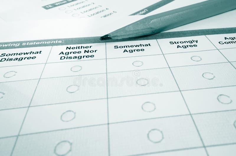 Survey macro. Closeup of a customer satisfaction survey and pencil stock photos