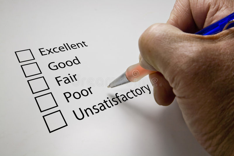Survey questionnaire. On white withpen in hand stock photography