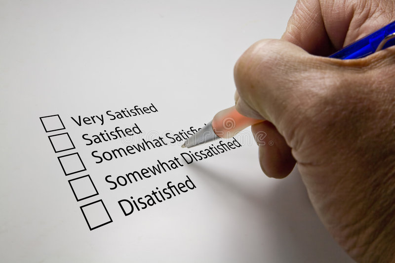 Survey questionnaire. On white with pen in hand stock photos