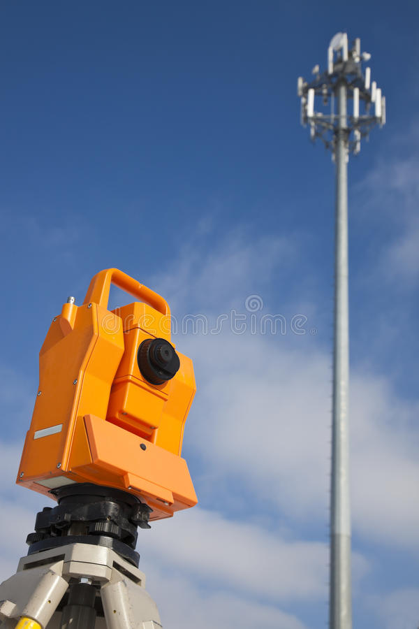 Surveying by cell phone tower stock image