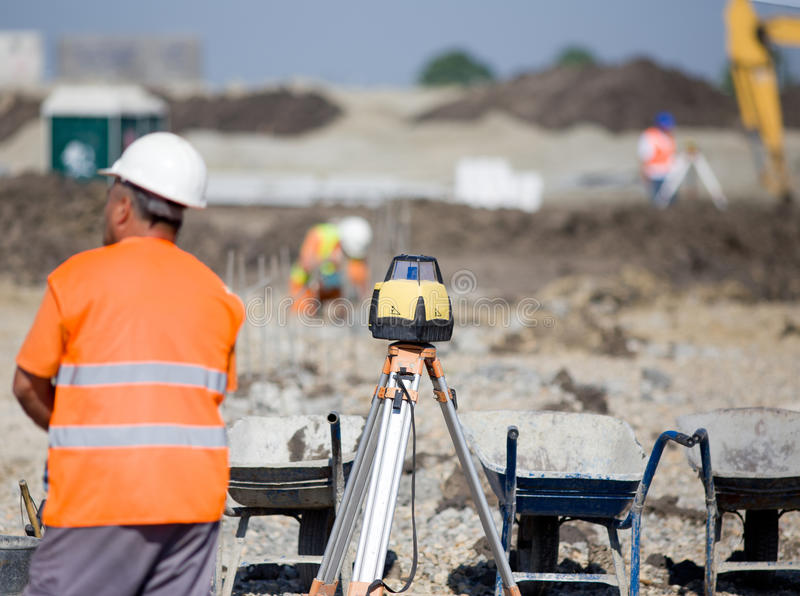 Surveying equipment at construction site royalty free stock photography