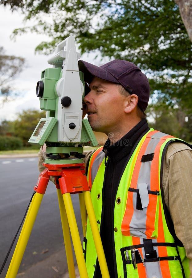 Download Surveyor checks his work stock photo. Image of engineering - 17645192