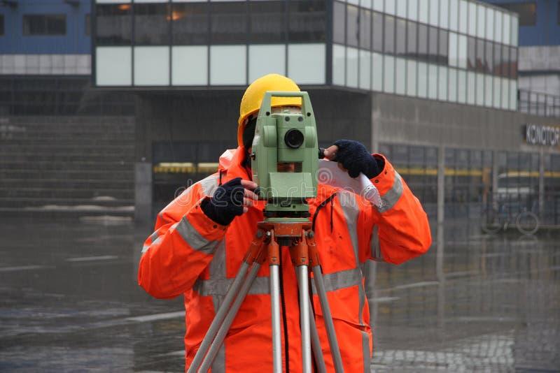 Surveyor measuring land stock photos