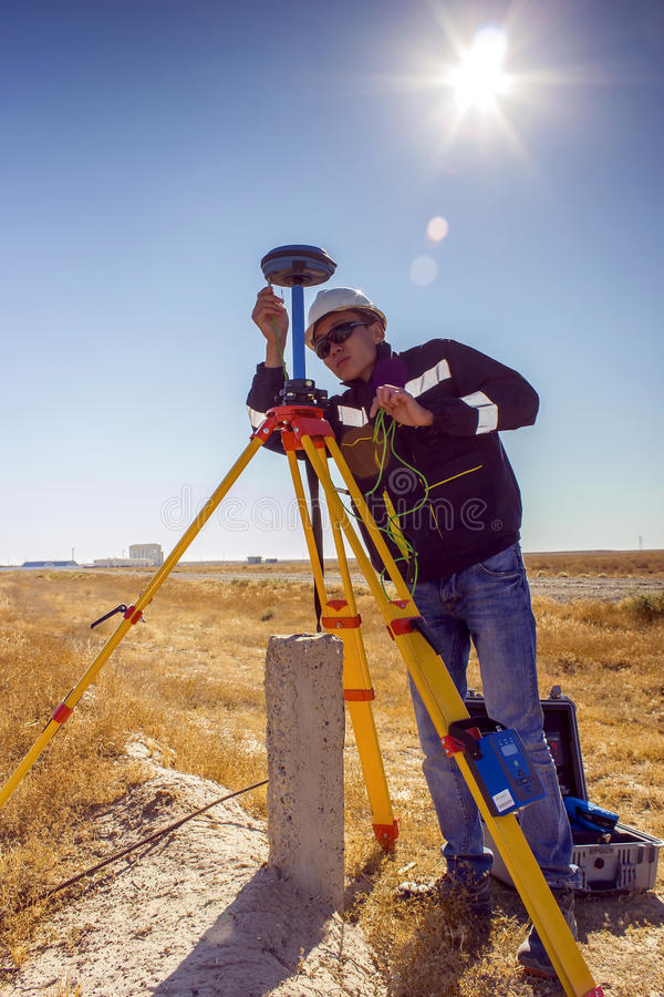 Surveyor. Sets of GPS equipment to determine the coordinates of the terrain stock photos