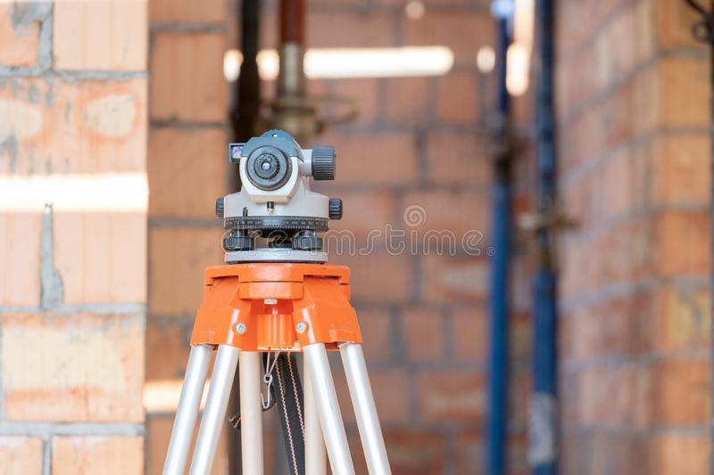 Surveyor systems or optical level device against blurred background stock photo