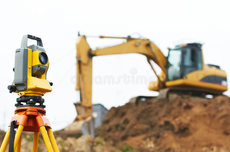 Surveyor theodolite on tripod stock photo