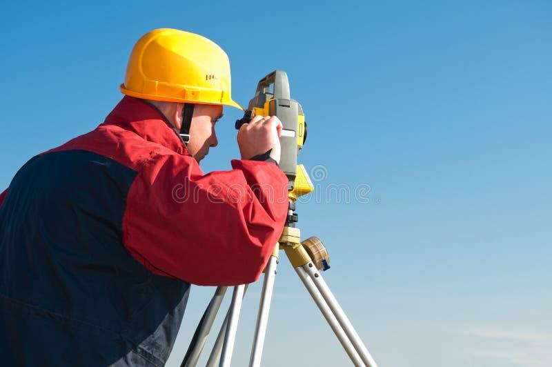 Surveyor theodolite works stock image