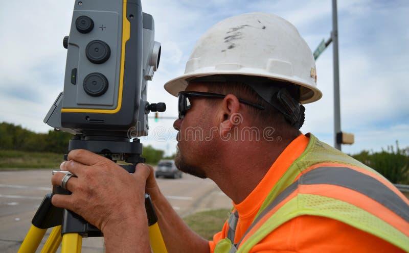 Surveyor Using Robot Equipment In The Field stock photo