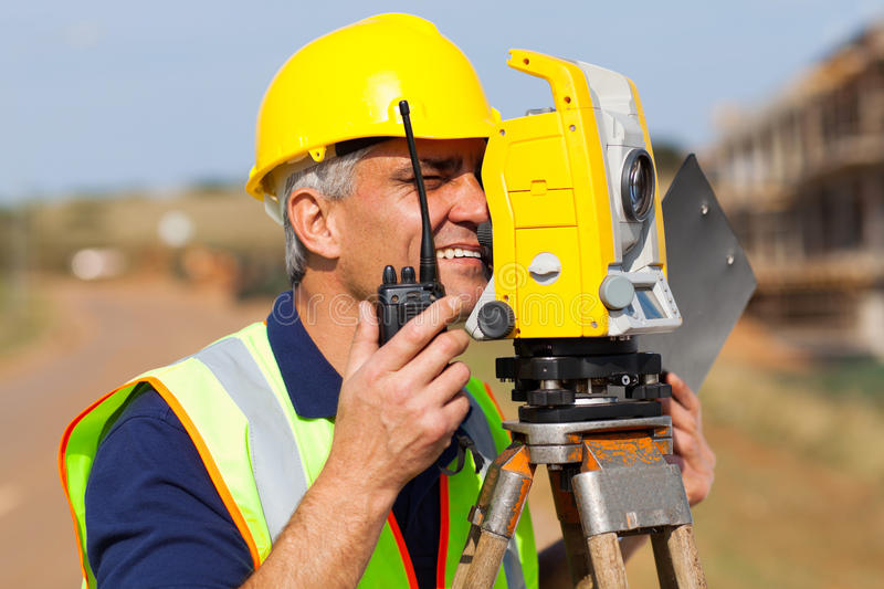Surveyor working tacheometer stock photography