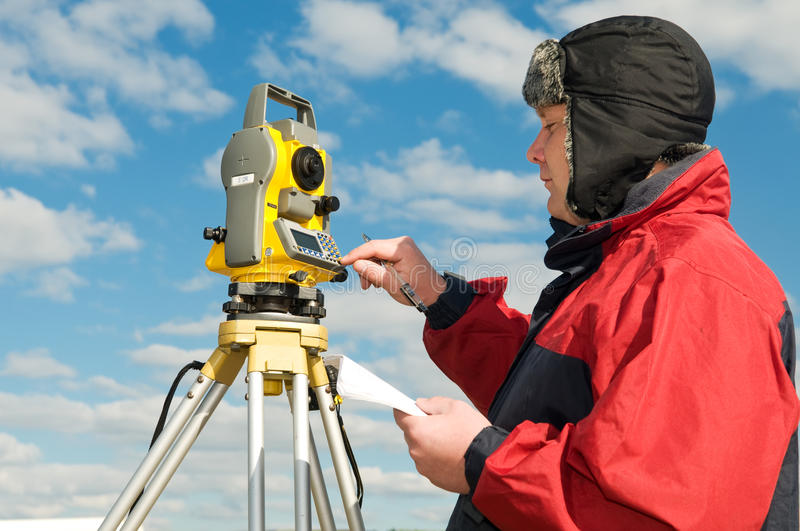 Download Surveyor Works With Theodolite Stock Photography - Image: 16343092