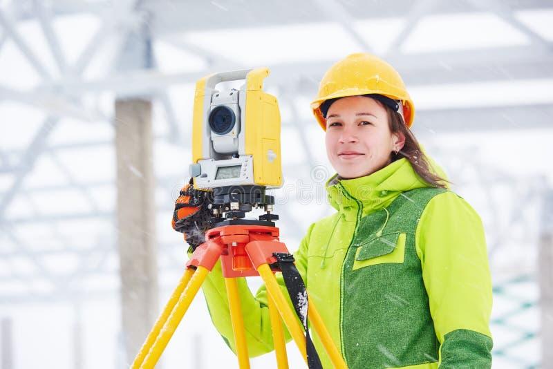 Surveyor works with theodolite stock photography
