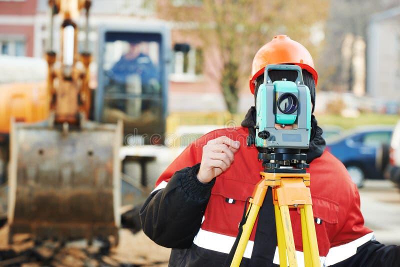 Surveyor works with theodolite royalty free stock photos