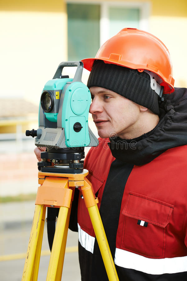 Surveyor works with theodolite stock image