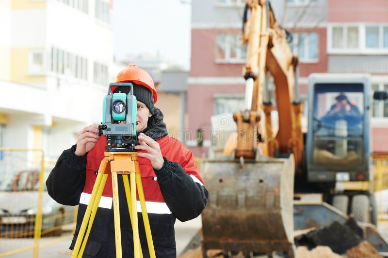 Surveyor works with theodolite royalty free stock photo