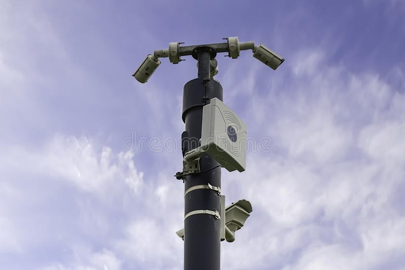 Survilance cameras. CCTV cameras and wifi station fitted on mast on british countryside.Blue sky with clouds in background.Technology Uk.Survilance state.Big stock photo