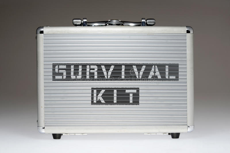 Survival kit BOX. Metallic box with survival kit phrase stencil print on it side royalty free stock images