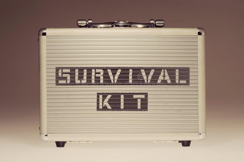 Survival kit case. Metallic case with survival kit phrase stencil print on it side royalty free stock photos