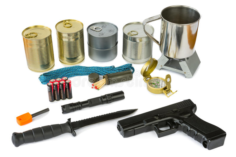 Survival kit with emergency supplies, flashlight and gun. Survival kit with emergency supplies, food, knife, flashlight and gun stock photos
