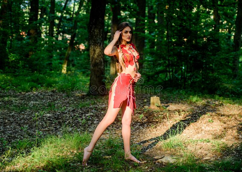 Survival lessons. A delicious girl. wild woman in forest. ethnic tribal fashion. deep forest. amazon woman. sexy witch royalty free stock photos