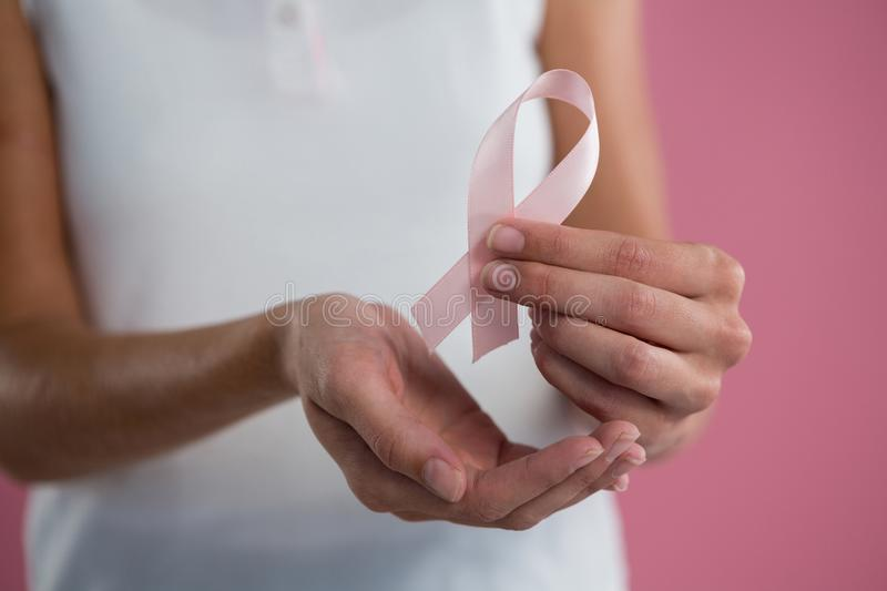 Survivors Text and Hand holding card with pink breast cancer awareness women royalty free stock photos