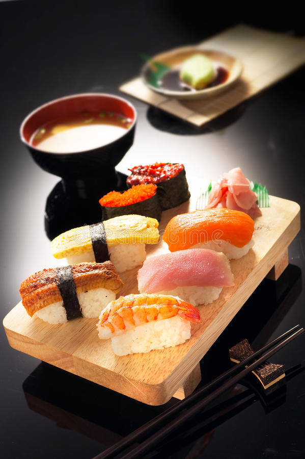 Sushi. Various kinds of sushi on wooden plate stock images