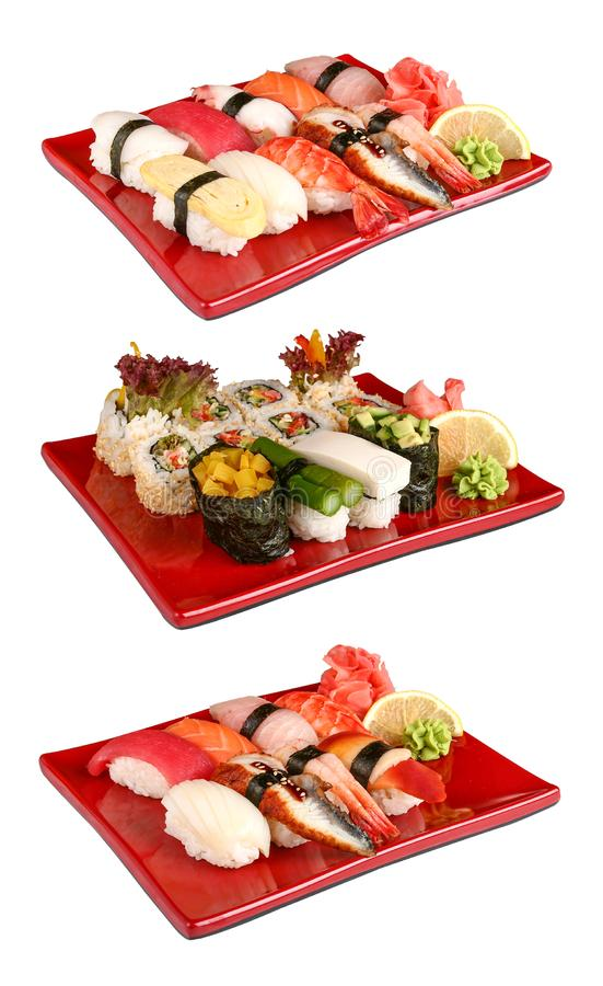 Sushi ajustado em placas vermelhas fotos de stock
