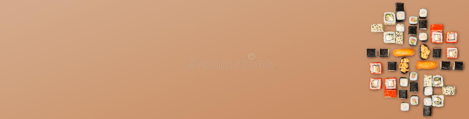 Sushi big party set on background with copy space, top view royalty free stock photo