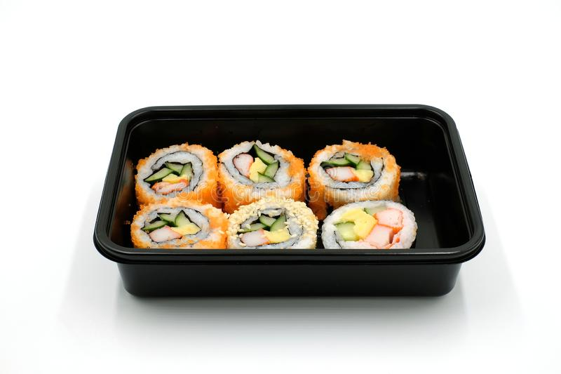 Sushi in a black plastic food box on white backgorund,. Japanese Food stock photos